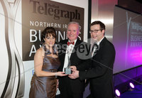 Press Eye - Belfast - Northern Ireland - Tuesday 24th April 2012 -  Picture by Kelvin Boyes / Press Eye.. 2012 Belfast Telegraph Northern Ireland Business Awards in association with bmi at the Ramada Hotel. MUST USE. Outstanding Business of the Year, sponsored by bmi. Bro McFerran of AllState NI is congratulated by David Elliott, Group Business Editor of the Belfast Telegraph, and Brenda Morgan, Sales Manager Ireland, British Midland International (bmi), after being named Outstanding Business of the Year at the 2012 Belfast Telegraph Northern Ireland Business Awards in association with bmi.