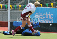 Mandatory Credit: Rowland White/Presseye. Women\'s Hockey: Irish Senior Cup Semi-Final. Teams: Queen\'s (blue) v Loreto (white). Venue: National Hockey Stadium, Dublin. Date: 12th May 2012. Caption: Nikki Symmons shoots for Loreto