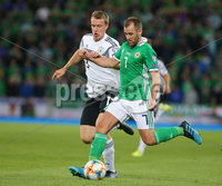 Press Eye - Belfast - Northern Ireland - 9th September 2019 . UEFA EURO Qualifier Group C at the National Stadium at Windsor Park, Belfast.  Northern Ireland Vs Germany. . Northern Ireland\'s Niall McGinn with Germany\'s Lukas Klostermann.. Photo by Jonathan Porter / Press Eye.