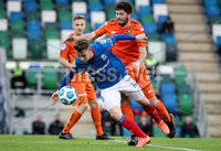 Danske Bank Premiership, National Football Stadium at Windsor Park, Belfast, Northern Ireland 17/10/2020. Linfield vs Carrick Rangers. Linfields Kyle McClean with Michael Smith of Carrick Rangers. Mandatory Credit INPHO/Declan Roughan