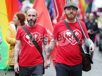 Press Eye - Belfast - Northern Ireland - 18th May 2019. Same sec marriage campaigners for Northern Ireland hold a march and rally in Belfast City Centre from Writers Square to the City Hall. The rally was addressed by the Sara Canning partner of Lyra McKee who was murdered after being shot dead by dissident republican in Derry last month.. John O\'Doherty(right) from the Rainbow Project pictured at the rally with his partner. . Picture by Jonathan Porter/PressEye