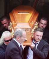 Press Eye - Belfast - Northern Ireland - 11th July 2018. Funeral for road racer William Dunlop at Garryduff Presbyterian Church outside Ballymoney in Co. Antrim.  The 32-year-old was killed while participating in the practise session of the Skerries 100 in Co. Dublin lat Saturday.  William\'s father Robert was also buried from Garryduff Presbyterian Church when he died at the North West 200 road race in 2008.. William Dunlop\'s family, including his brother Michael(back right) carry his coffin from the church after the funeral service. . Picture by Jonathan Porter/PressEye