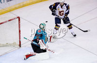 Press Eye - Belfast -  Northern Ireland - 10th October 2018 - Photo by William Cherry/Presseye. Belfast Giants\' Tyler Beskorowany with Guildford Flames\' Jamie Crooks during Wednesday nights Elite Ice Hockey League game at the SSE Arena, Belfast.        Photo by William Cherry/Presseye.