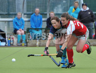 Mandatory Credit: Rowland White/Presseye. Women\'s Irish Hockey League. Teams: Pegasus (red) v Hermes (blue). Venue: The Dub. Date: 21st April 2012. Caption: Michelle Harvey, Pegasus and Eimear Horan, Hermes