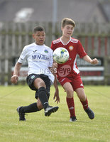 26th  July 2018. SuperCupNI 2018 Minor  section semi final between Greenisland and Portadown at Seahaven Portstewart.. Greenisland\'s Reece Black in action with Portadowns Steven Reid.  Mandatory Credit: Stephen Hamilton /Presseye