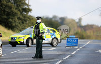 Press Eye - Belfast - 18th October 2020 - . General view of PSNI officers at the scene on the Moira Road, Lisburn where 18 year old Josh Fletcher died in the early hours of Sunday 18th October.. Sergeant Jonny Mackenzie said: Josh was the driver of a car which left the road after colliding with a cow at around 3am on Sunday morning and sadly died at the scene as a result of his injuries. We are currently conducting a number of follow up enquiries into the collision and the road remains closed at this time with diversions in place.. Photo by Press Eye. .