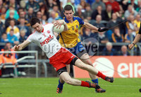 All Ireland Senior Football Championship Qualifier Round 2, Dr. Hyde Park, Roscommon 14/7/2012. Roscommon vs Tyrone. Conor Clarke of Tyrone with Cathal Shine of Roscommon. Mandatory Credit ©INPHO/Donall Farmer