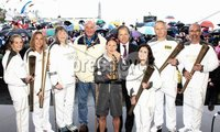 ©Press Eye Ltd Northern Ireland - 7th June 2012. Mandatory Credit - Picture by Darren Kidd/Presseye.com . Larne Borough Council and the Borough\'s six local torch bearers bid the Olympic torch farewell from the Port of Larne as the Northern Ireland leg of the London 2012 relay concluded yesterday. Pictured are from L-R Kate Irvine, Dianne McMillan, Nicola Blythe, Dawn Aston, Trevor Ringland and David Boyle with Mayor of Larne, Cllr Bobby McKee MBE and The Rt Hon Hugo Swire MP Minister of State for Northern Ireland with the olympic flame .  .  .