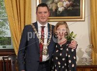 21 May 2019, Mandatory Credit Press Eye/Darren Kidd.  Media release on behalf of Belfast City Council. Lord Mayor of Belfast councillor John Finucane pictured with his mum Geraldine Finucane. . 21 May 2019. For immediate release. New Lord Mayor of Belfast installed at AGM. Sinn Fein councillor John Finucane has tonight been installed as the new Lord Mayor of Belfast.. The 39-year-old father of four, a newly-elected councillor in the recent Local Government Election, takes over from outgoing Lord Mayor and party colleague, Councillor Deirdre Hargey.. Speaking about his appointment, Councillor Finucane said: Its a privilege for me to be taking over the chain of office from Deirdre and I will continue to keep equality and rights at the heart of my term of office.. I want to be a Lord Mayor for all the people of Belfast, to celebrate our diversity as a city and promote inclusivity; to build economic prosperity and tackle issues such as climate change, which impacts on everyone and affects everyones quality of life.. He added: The Belfast Agenda has ambitions to see a Belfast reimagined, well-connected, culturally vibrant, and a magnet for talent. During my term of office, I will be seeking opportunities to continue to showcase the city and its people, to continue to drive change and build on existing momentum.. Councillor Finucane represents the Castle electoral area of the city.. Also at tonights AGM, Councillor Peter McReynolds was elected Deputy Lord Mayor. The Alliance party councillor takes over from outgoing Deputy Lord Mayor and party colleague, Councillor Emmet McDonough-Brown.. The Alliance councillor is a representative for Ormiston area.. ENDS. ISSUED BY MARKETING & CORPORATE COMMUNICATIONS, BELFAST CITY COUNCIL. For media enquiries and more information please contact:. Press Office, Belfast City Council. Tel: 028 90270221. Out of hours: 07917 458070