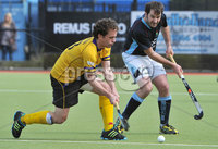 Mandatory Credit: Rowland White/Presseye. Men\'s Hockey: Irish Senior Cup Quarter-Final. Teams: Lisnagarvey (blue) v Pembroke Wanderers (yellow). Venue: Lisnagarvey. Date: 28th April 2012. Caption: Paddy Conlon, Pembroke and Michael Harte, Lisnagarvey