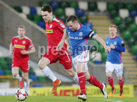 Tennent\'s Irish Cup Quarter-Final, Windsor Park, Belfast 13/3/2018 . Linfield vs Cliftonville. Linfield\'s Jamie Mulgrew with Cliftonville\'s Conor McDonald. Mandatory Credit ©INPHO/Jonathan Porter