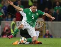 Press Eye - Belfast - Northern Ireland - 9th September 2019 - Picture Matt Mackey / Press Eye.. EURO qualifier 2020 Stadium at Windsor Park, Belfast. Northern Ireland Vs Germany.. Northern Ireland\'s Conor Washington with Germany\'s Julian Brandt.