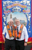 Press Eye - Belfast - Northern Ireland - 12th July 2018. Annual Orange Order parade takes place in Belfast with lodges and bands making their way through the city centre to the field at Shaws Bridge. . Billy McIlwaine with his father Tommy from St Paul\'s Church LOL 1960. Picture by Jonathan Porter/PressEye
