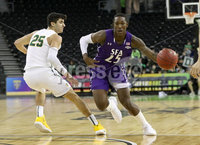 Press Eye - Belfast -  Northern Ireland - 30th November 2018 - Photo by William Cherry/Presseye. San Francisco\'s Jordan Ratinho with Stephen F. Austin\'s Karl Nicholas during Friday afternoons game in the Goliath bracket of the Basketball Hall of Fame Belfast Classic at the SSE Arena, Belfast.