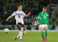 Press Eye - Belfast - Northern Ireland - 9th September 2019 . UEFA EURO Qualifier Group C at the National Stadium at Windsor Park, Belfast.  Northern Ireland Vs Germany. . Northern Ireland\'s Gavin Whyte with Germany\'s Marcel Halstenberg.  . Photo by Jonathan Porter / Press Eye.