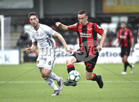 11th July 2019. Europa league First round qualifying match between Crusaders and B36 Torshavn at Seaview Belfast.. Crusaders Paul Heatley  in action with Torshavns Eli Nielsen. Mandatory Credit / Stephen Hamilton/Inpho