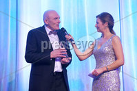 Press Eye - Belfast - Northern Ireland - 6th February 2017 -  . Belfast Telegraph Sports Awards 2016.. Award 6 - Local Heroes Award. Slaughtneill GAA won the Local Heroes Award, sponsored by Crowne Plaza Belfast. It was presented by Rajesh Rana, Director of Crowne Plaza Belfast and Dame Mary Peters..  . Chair Sean McGuigan with Claire McCollum . Photo by Kelvin Boyes / Press Eye..