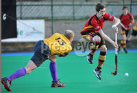 Mandatory Credit: Rowland White/Presseye. Men\'s Hockey: Irish Hockey League. Teams: Banbridge (red) v Instonians (yellow). Venue: Banbridge. Date: 14th April 2012. Caption: Paddy Brown, Instonians and Owen Magee, Banbridge