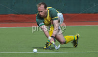Mandatory Credit: Rowland White/Presseye. Men\'s Hockey: Irish Senior Cup Semi-Final. Teams: Lisnagarvey (blue) v Railway Union (yellow)). Venue: National Hockey Stadium, Dublin. Date: 12th May 2012. Caption: Kenny Carroll, Railway Union