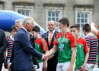 Press Eye - Belfast -  Northern Ireland - 22nd May 2019 - Photo by William Cherry/Presseye. . The Prince of Wales is pictured at the Palace Demesne, Armagh during his 2 day visit to Northern Ireland.  He met Ulster and Ireland Rugby star Rory Best and Manager of Armagh County GAA, Kieran McGeeney during a \'game of two halves\' which brings together young rugby and GAA players