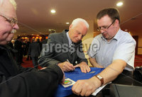 Press Eye - Belfast - Northern Ireland - Saturday 28th April 2012 -  Picture by Kelvin Boyes / Press Eye.. Linfield veterans from 1961-62 at the Ramada Hotel Belfast.. Jim Reid signs his autograph for fans.