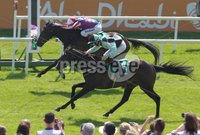 Curragh Racing, The Curragh, Co. Kildare 27/5/2012. The Paddy Power Handicap. Marc Monaghan on Midnight Soprano (no.5) snatches victory on the line from Johnny Murtagh on Royal Diamond (No.4). Mandatory Credit ©INPHO/Lorraine O\'Sullivan