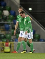 11th August 2018. International Friendly match between . Northern Ireland and Israel  at the national stadium in Belfast.. Northern Irelands Gavin Whyte with Johnny Evans .  Mandatory Credit: Stephen Hamilton /Presseye