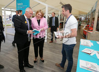Press Eye - Belfast - Northern Ireland - 16th May 2019. Second day of the Balmoral Show, in partnership with Ulster Bank.  Pictured at Balmoral Park, outside Lisburn, are the Secretary of State for Northern Ireland Karen Bradley(centre) and Head of Ulster Bank Richard Donnan(left) and Ulster Bank Comber Branch Manger Aaron Bloomfield who were looking at Ulster Bank\'s Food Trail for the show.  Ulster Bank has provided space in its market at Balmoral Show to entrepreneurs from Ulster Bank\'s Entrepreneur Accelerator programme as well as small business customers. . Picture by Jonathan Porter/PressEye