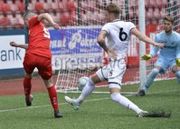 Press Eye - Belfast - Northern Ireland -15th July. Photo by Stephen Hamilton  / Press Eye.. Pre season friendly match between Cliftonville and Swansea u23 at Solitude in Belfast.. Cliftonvilles Daniel Hughes  in action with Swansea\'s Joe Rodon
