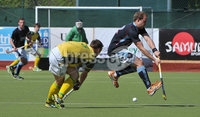 Mandatory Credit: Rowland White/Presseye. Men\'s Hockey: Irish Senior Cup Semi-Final. Teams: Lisnagarvey (blue) v Railway Union (yellow)). Venue: National Hockey Stadium, Dublin. Date: 12th May 2012. Caption: Kenny Carroll, Railway Union and Timmy Cockram, Lisnagarvey