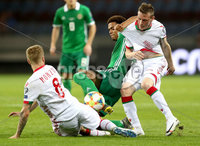 Press Eye - Belfast -  Northern Ireland - 11th June 2019 - Photo by William Cherry/Presseye. Belarus\' Nikita Korzun and Yuri Kovalev with Northern Ireland\'s Jamal Lewis during Tuesday nights UEFA EURO 2020 Qualifier at the Borisov Arena, Belarus.      Photo by William Cherry/Presseye