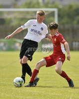 26th  July 2018. SuperCupNI 2018 Minor  section semi final between Greenisland and Portadown at Seahaven Portstewart.. Greenisland\'s Jack Patterson in action with Portadowns Johnny McCullough.  Mandatory Credit: Stephen Hamilton /Presseye