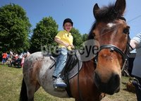 Northern Ireland- 27th May 2012 Mandatory Credit - Photo-Jonathan Porter/Presseye.   The National Countrysports Fair at Moria Demesne.  Seven-year-old Adam Connor from Belfast enjoys some pony trekking.