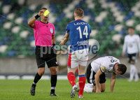 Press Eye - Belfast -  Northern Ireland - 10th July 2019 - Photo by William Cherry/Presseye/Inpho. Linfield\'s Shayne Lavery gets a yellow card during Wednesday nights Champions League, Qualifying First Round, 1st Leg game at the National Stadium at Windsor Park, Belfast.
