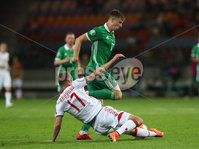 Press Eye - Belfast -  Northern Ireland - 11th June 2019 - Photo by William Cherry/Presseye. Belarus\' Nikita Naumov with Northern Ireland\'s Paddy McNair during Tuesday nights UEFA EURO 2020 Qualifier at the Borisov Arena, Belarus.      Photo by William Cherry/Presseye