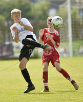 26th  July 2018. SuperCupNI 2018 Minor  section semi final between Greenisland and Portadown at Seahaven Portstewart.. Greenisland\'s Bradley Maguire  in action with Portadowns Jude O\'Hara.  Mandatory Credit: Stephen Hamilton /Presseye