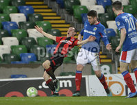 21/02/2020. Danske Bank Irish Premiership match between Linfield and Crusaders at The National Stadium.. Linfields  Mark Haughey in action with Crusaders Paul Heatley . Mandatory Credit  Inpho/Stephen Hamilton