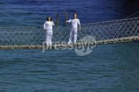 Press Eye - Belfast - Northern Ireland -4th June 2012. Day 17 of the Olympic Torch Relay at Carick-a-Rede Rope Bridge on the North Antrim Coast. ©Russell Pritchard / Presseye