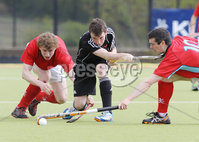 Press Eye - Belfast - Northern Ireland - Sunday 6th May 2012 -  Picture by Kelvin Boyes / Press Eye . Electric Ireland Men\'s Hockey League Final between Lisnagarvey and Dublin YMCA at Lisnagarvey Hockey Club, Hillsborough.. Peter MacDonnell and Mark Raphael of Lisnagarvey and  Robert Wheelan of Dublin YMCA