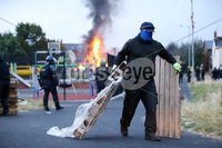 Press Eye - Belfast - Northern Ireland - 11th July  2018 . General view of the Bloomfield Walkway bonfire in east Belfast.. The east Belfast bonfire was set alight hours after a court ordered its height to be reduced ahead of the 11th July.. A large police operation was also put in place with over 100 PSNI officers in riot gear present at the scene.. Contractors remove bonfire material from the site.. Photo by Kelvin Boyes / Press Eye..