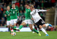 Press Eye - Belfast -  Northern Ireland - 09th September 2019 - Photo by William Cherry/Presseye . Northern Ireland\'s Jonny Evans with Germany\'s Julian Brandt during Monday nights European Championship Qualifier at the National Stadium at Windsor Park, Belfast.  Photo by William Cherry/Presseye
