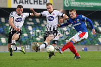 Unite the Union Champions Cup First Leg, National Football Stadium at Windsor Park, Belfast 8/11/2019. Linfield vs Dundalk. Linfield\'s Shayne Lavery and Sean Hoare of Dundalk. Mandatory Credit  INPHO/Brian Little
