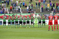 4th August 2018. Danske Bank Irish premier league match between Glentoran and Cliftonville at The Oval in Belfast.. Glentoran and Cliftonville players observe a minutes silence followed by applause for ex player Ron Manley.  Mandatory Credit: Stephen Hamilton /Inpho