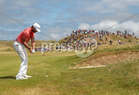 2018 Dubai Duty Free Irish Open, Ballyliffin Golf Club, Co. Donegal 8/7/2018. Erik van Rooyen hits an approach shot onto the 1st green . Mandatory Credit ©INPHO/Oisin Keniry