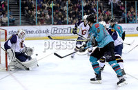 Press Eye - Belfast, Northern Ireland - 29th February 2020 - Photo by William Cherry/Presseye. Belfast Giants\' Liam Morgan with Guildford Flames\' Wouter Peeters during Saturday nights Elite Ice Hockey League game at the SSE Arena, Belfast.    Photo by William Cherry/Presseye
