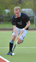 Mandatory Credit: Rowland White/Presseye. Men\'s Hockey: Irish Senior Cup Quarter-Final. Teams: Lisnagarvey (blue) v Pembroke Wanderers (yellow). Venue: Lisnagarvey. Date: 28th April 2012. Caption: Stuart McNeice, Lisnagarvey
