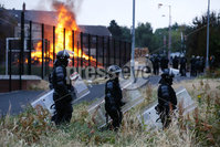 Press Eye - Belfast - Northern Ireland - 11th July  2018 . General view of the Bloomfield Walkway bonfire in east Belfast.. The east Belfast bonfire was set alight hours after a court ordered its height to be reduced ahead of the 11th July.. A large police operation was also put in place with over 100 PSNI officers in riot gear present at the scene.. Photo by Kelvin Boyes / Press Eye..
