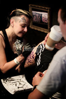 ©Press Eye Ltd Northern Ireland -29th April 2012 - Mandatory Credit - Picture by Matt Mackey/presseye.com. Tattoo addicts gather in Belfast\'s Ulster Hall for the Northern Ireland Tattoo Convention. The Hall has been turned into a giant tattoo studio for two days as hundreds of people get Ink put onto their skin canvasses.