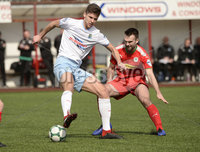 13th April 2019. Danske Bank Irish premiership. Cliftonville v Ballymena United at Solitude Belfast.. Cliftonville\'s Jamie Harney  in action with Ballymena\'s  Adam Leckey. Mandatory Credit -Inpho/Stephen Hamilton .