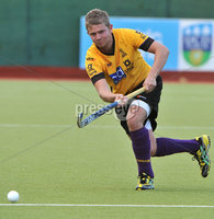 Mandatory Credit: Rowland White/Presseye. Men\'s Hockey: Irish Senior Cup Semi-Final. Teams: Cork Harlequins (black) v Instonians (yellow). Venue: National Hockey Stadium, Dublin. Date: 12th May 2012. Caption: Matthew Martin, Instonians